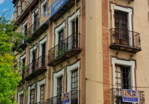 Reformas constructora en sevilla for Oficina pelayo sevilla